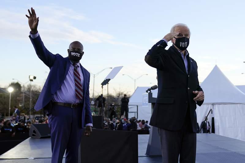 President-elect Joe Biden campaigns in Atlanta, Monday, Jan. 4, 2021, for Senate candidates Raphael Warnock, left, and Jon Ossoff. (AP Photo/Carolyn Kaster)