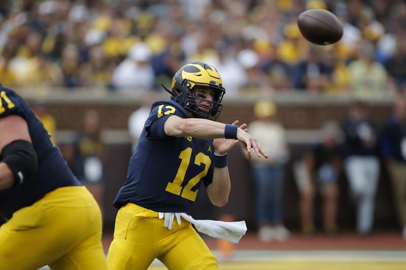 Michigan quarterback Cade McNamara (12) throws a pass against Western Michigan during an NCAA football game on Saturday, Sept. 4, 2021, in Ann Arbor, Mich.