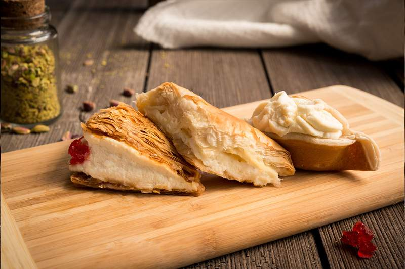 Kashta, meaning Rosewater in Arabic, is the base of delicious Kashta cream. This rich, sweet cream is the filling of fried Kellajj, baked Shouiebieh, and rich and creamy Cream Caramel. Photo: Shatila Bakery in Dearborn