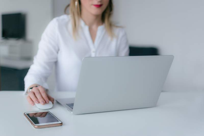 A woman at her laptop.