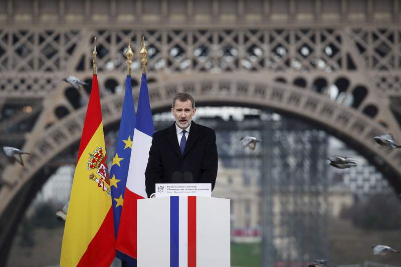 Spain's King Felipe VI arrives to deliver his speech during a ceremony to honor victims of terror attacks in Europe, at the Trocadero in Paris, Wednesday March 11, 2020. French President Emmanuel Macron and King of Spain Felipe VI are paying homage to victims of terrorism in a special ceremony prompted by attacks that hit both their countries and changed Europe's security posture. (Gonzalo Fuentes/Pool via AP)