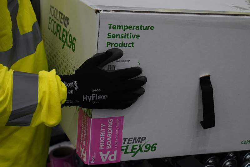 Boxes containing the Moderna COVID-19 vaccine are prepared to be shipped at the McKesson distribution center in Olive Branch on December 20, 2020 in Olive Branch, Mississippi. (Photo by Paul Sancya - Pool/Getty Images)