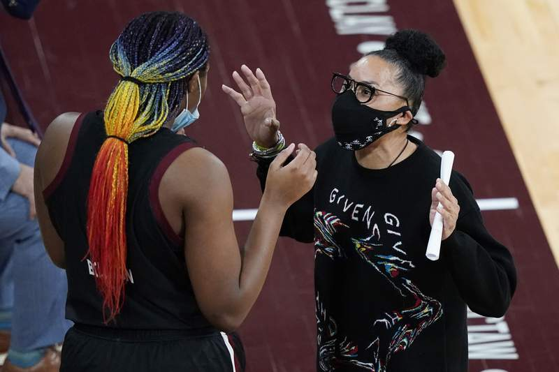 South Carolina coach Dawn Staley confers with  forward Aliyah Boston on the sideline during the second half of the team's NCAA college basketball game against Mississippi State in Starkville, Miss., Thursday, Jan. 28, 2021. South Carolina won 75-52. (AP Photo/Rogelio V. Solis)