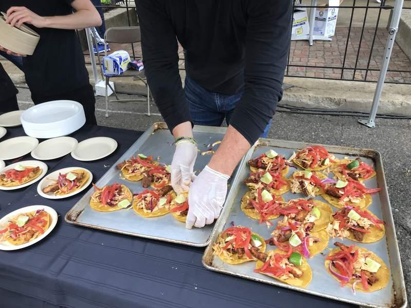 A team member of Black Pearl prepares fish tacos during the Taste of Ann Arbor on June 3, 2018.