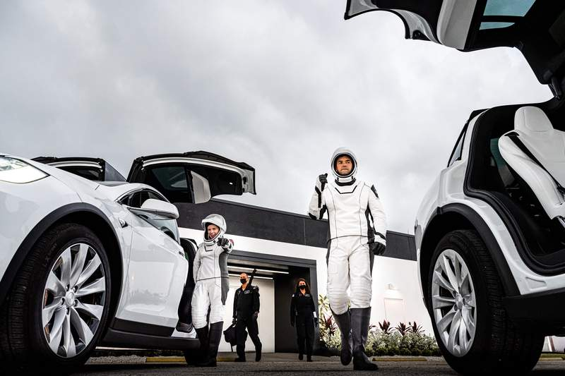 Inspiration4 crew Jared Isaacman and Hayley Arcenauex walkout of SpaceX facilities during a launch dress rehearsal