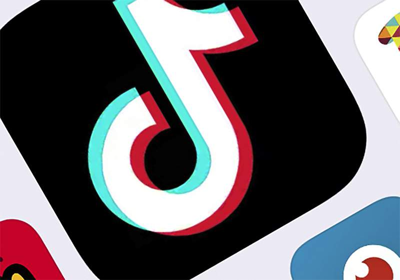 """FILE - This Feb. 25, 2020, file photo, shows the icon for TikTok in New York.   President Donald Trump will order Chinas ByteDance to sell its hit video app TikTok because of national-security concerns, according to reports published Friday, July 31, 2020. We are looking at TikTok,"""" Trump told reporters Friday at the White House. """"We may be banning TikTok. (AP Photo/File)"""