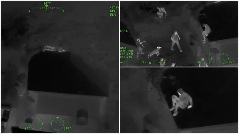Michigan State Police chopper images of a suspect hiding on a roof in Detroit.