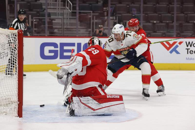 DETROIT, MICHIGAN - FEBRUARY 19: Patric Hornqvist #70 of the Florida Panthers scores a first period goal past Thomas Greiss #29 of the Detroit Red Wings at Little Caesars Arena on February 19, 2021 in Detroit, Michigan. (Photo by Gregory Shamus/Getty Images)