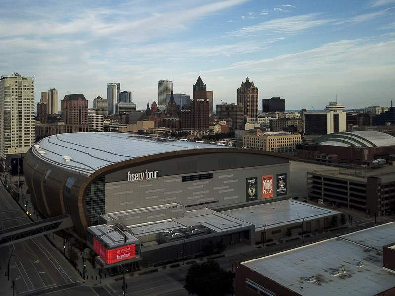FILE - In this July 29, 2020 file photo, The Fiserv Forum is seen in Milwaukee. Election officials said Tuesday, Oct. 6, 2020, that they scrapped their plans to use the Milwaukee Bucks and Brewers' stadiums as early voting sites in the presidential battleground state of Wisconsin. Milwaukee's election commission had planned to use Fiserv Forum and Miller Park between Oct. 20 and Nov. 1 as sites where people could have voted early in-person or returned absentee ballots they received by mail. The commission developed the plan in an effort to provide safe voting sites during the coronavirus pandemic. (AP Photo/Morry Gash File)