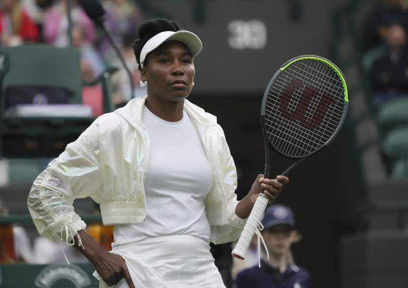 FILE - Venus Williams arrives on court for the women's singles second round match against Tunisia's Ons Jabeur in the Wimbledon Tennis Championships in London, Wednesday June 30, 2021. Williams will be back at the U.S. Open after being given a wild card Wednesday, Aug. 18, 2021 into the Grand Slam tournament. (AP Photo/Alberto Pezzali, file)
