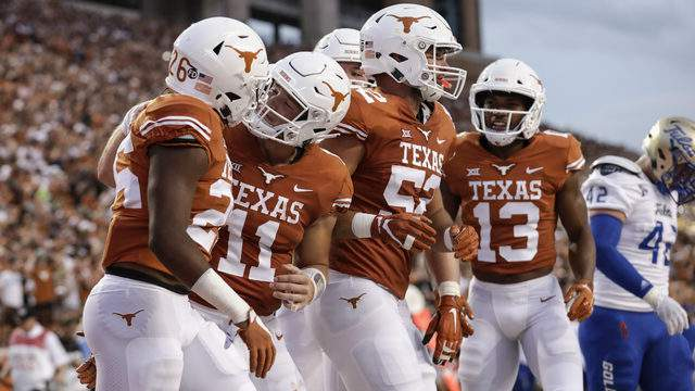 Sam Ehlinger #11 of the Texas Longhorns congratulates Keaontay Ingram #26 after a touchdown in the first half against the Tulsa Golden Hurricane at Darrell K Royal-Texas Memorial Stadium on September 8, 2018 in Austin, Texas. (Photo by Tim Warner/Getty Images)