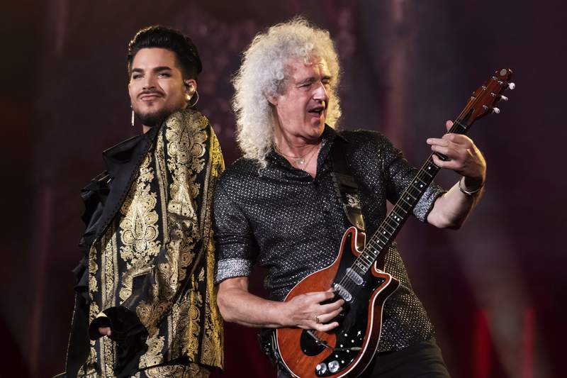 FILE - In this Sept. 28, 2019 file photo, Adam Lambert, left, and Brian May, of Queen, perform at the Global Citizen Festival in New York. Lambert and May, along with bandmate Roger Taylor, recently gathered virtually to record a new version of the Queen classic, We Are the Champions. You Are the Champions was released early Friday on all streaming and download services, with proceeds going to the World Health Organizations COVID-19 Solidarity Response Fund.  (Photo by Charles Sykes/Invision/AP, File)