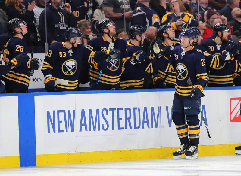 BUFFALO, NY - FEBRUARY 11: Sam Reinhart #23 of the Buffalo Sabres celebrates his goal with teammates during the third period against the Detroit Red Wings at KeyBank Center on February 11, 2020 in Buffalo, New York. Buffalo defeated Detroit 3-2. (Photo by Timothy T Ludwig/Getty Images)