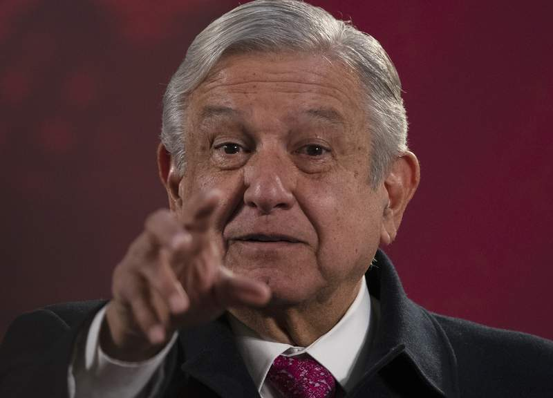 """Mexican President Andres Manuel Lopez Obrador gives his regularly scheduled morning press conference known as """"La Maanera"""" at the National Palace in Mexico City, Friday, Dec. 18, 2020. Las Maaneras are a platform for the president to relay information he says the media ignore or misrepresent. (AP Photo/Marco Ugarte)"""