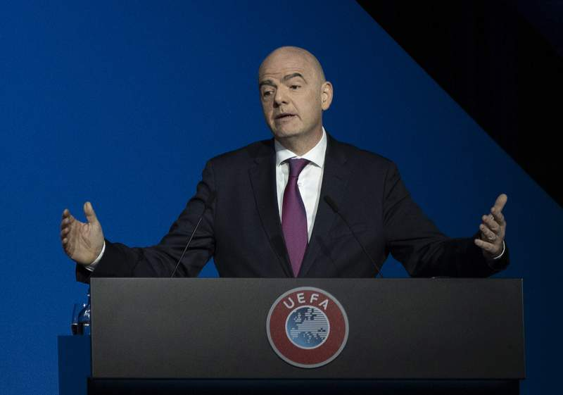 FILE - In this Tuesday March 3, 2020 file photo, FIFA President Gianni Infantino addresses a meeting of European soccer leaders at the congress of the UEFA governing body in Amsterdam, Netherlands. A special prosecutor in Switzerland on Thursday Dec. 10, 2020, has recommended opening a criminal investigation against FIFA President Gianni Infantino for using a private jet in 2017. (AP Photo/Peter Dejong, File)