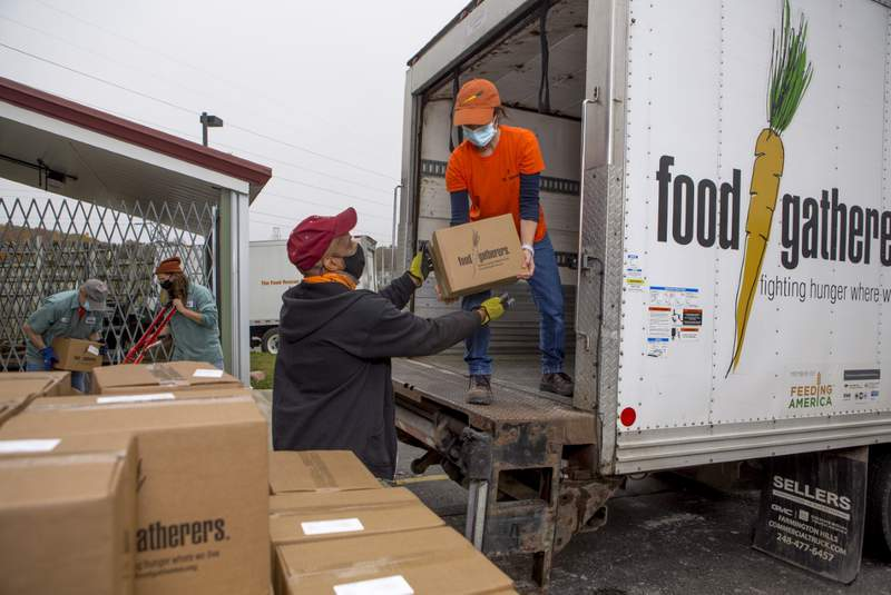 Food Gatherers staff unload food from a truck.