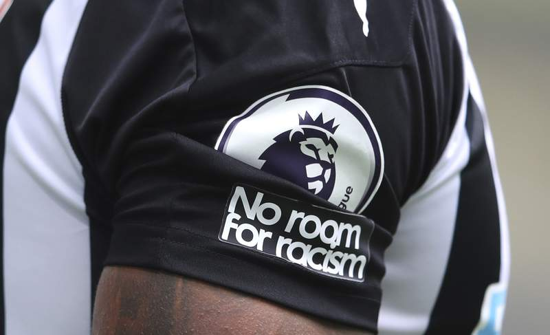 """FILE - In this Sunday, Sept. 20, 2020 file photo, Aadetailed view of the """"No room for racism"""" badge on the shirt of Newcastle United's Callum Wilson during the English Premier League soccer match between Newcastle United and Brighton at St. James' Park in Newcastle, England. The leaders of English soccer have asked the heads of Facebook and Instagram to show basic human decency by taking more robust action to eradicate racism and for users identities to be verified. There has been growing outrage that players from the Premier League to the Womens Super League have been targeted with abuse on Twitter and Facebook-owned Instagram. (Alex Pantling /Pool via AP, File)"""