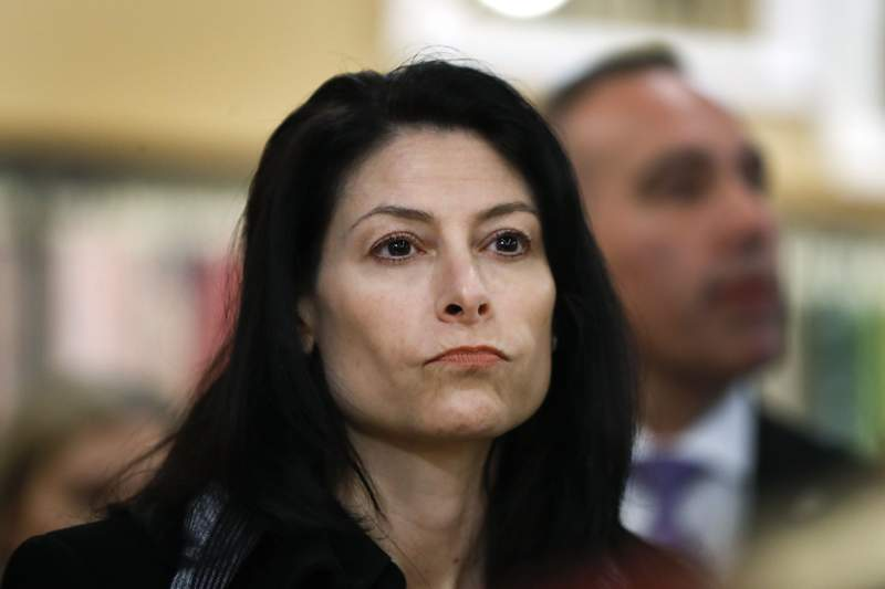 FILE - In this March 18, 2019, file photo, Michigan Attorney General Dana Nessel attends an event in Clawson, Mich. Enbridge Inc. said Friday, March 6, 2020, it has hired companies to design and build a disputed oil pipeline tunnel beneath the channel linking Lakes Huron and Michigan, despite pending legal challenges. Nessel is appealing a Michigan Court of Claims ruling in October 2019 that upheld an agreement between Enbridge and former Republican Gov. Rick Snyder's administration to drill the tunnel through bedrock beneath the straits. (AP Photo/Paul Sancya File)