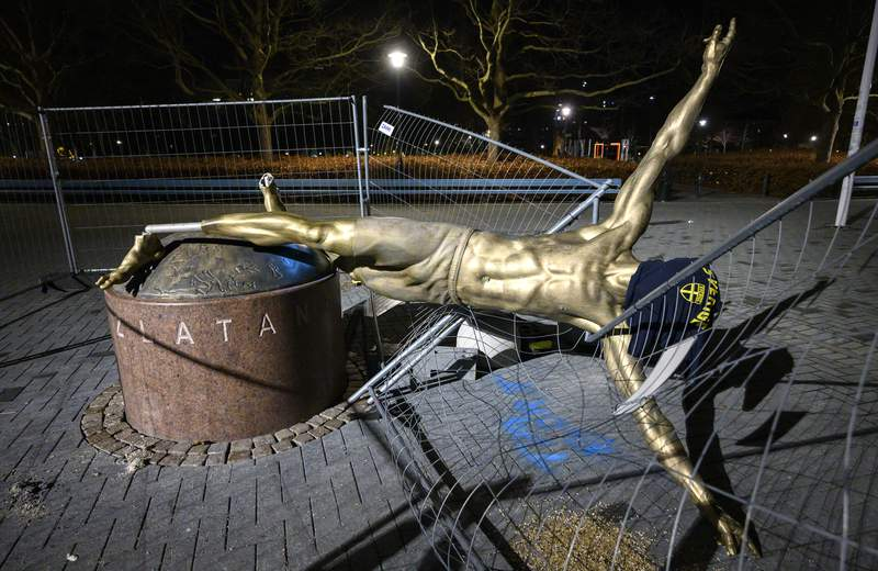 FILE - In this Sunday Jan. 5, 2020 file photo, the damaged statue of soccer player Zlatan Ibrahimovic next to Stadion football arena in Malmo, Sweden. The much-vandalized statue of Zlatan Ibrahimovic is staying in Malmo. Committee members from the Swedish citys council have held a meeting Monday, May 18 to discuss proposals from local citizens about where to move the statue of the soccer player from its current location outside Malmos stadium. The bronze sculpture has been repeatedly attacked since Ibrahimovic become a part-owner in Hammarby.(Johan Nilsson/TT via AP, file)