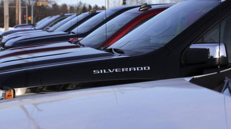 In this Jan. 9, 2020, photo Chevrolet Silverado pick-up trucks are lined up on the sales lot at the Betley Chevrolet dealership in Derry, N.H. On Friday, Jan. 31, the Commerce Department issues its December report on consumer spending, which accounts for roughly 70 percent of U.S. economic activity. (AP Photo/Charles Krupa)
