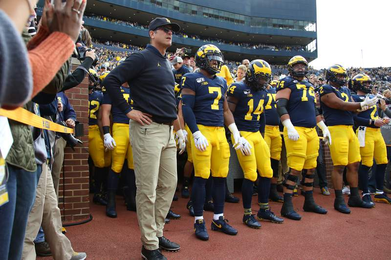 Head coach Jim Harbaugh waits to take the field to play the Iowa Hawkeyes at Michigan Stadium on October 05, 2019 in Ann Arbor, Michigan. Michigan won the game 10-3.