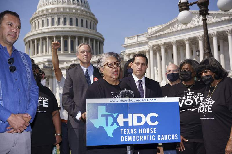 Rep. Senfronia Thompson, dean of the Texas House of Representatives, is joined by Sen. Jeff Merkley, D-Ore., left center, and other Texas Democrats, as they continue their protest of restrictive voting laws, at the Capitol in Washington, Friday, Aug. 6, 2021. (AP Photo/J. Scott Applewhite)