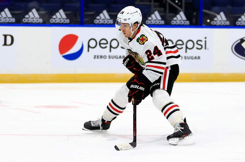 TAMPA, FLORIDA - JANUARY 13: Pius Suter #24 of the Chicago Blackhawks shoots shoots during a game against the Tampa Bay Lightning on opening night of the 2020-21 NHL season  at Amalie Arena on January 13, 2021 in Tampa, Florida. (Photo by Mike Ehrmann/Getty Images)