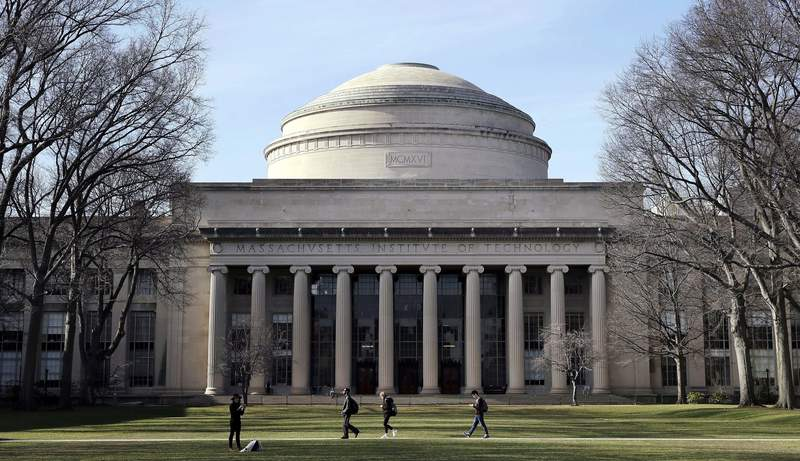 """FILE - In this April 3, 2017 file photo, students walk past the """"Great Dome"""" atop Building 10 on the Massachusetts Institute of Technology campus in Cambridge, Mass.  The worlds biggest AI society awarded its top prize Wednesday, Sept. 23, 2020,  to Regina Barzilay, a professor at MITs Computer Science and Artificial Intelligence Laboratory. MIT says Barzilay is a breast cancer survivor whose 2014 diagnosis led her to shift her machine-learning work to creating systems for drug development and early cancer diagnosis.  (AP Photo/Charles Krupa, File)"""