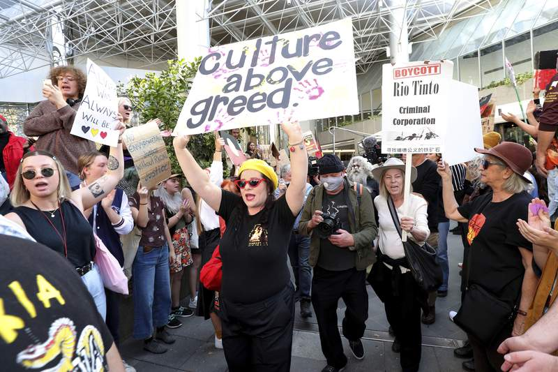 Protesters rally outside the Rio Tinto office in Perth, Australia, on June 9, 2020. Rio Tinto chairman Simon Thompson said Wednesday, March 3, 2021 he was accountable for the mining giant destroying sacred Indigenous sites in Australia to access iron ore and he will not seek reelection as a board director next year. (Richard Wainwright/AAP Image/ via AP)