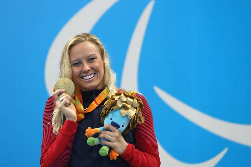 Gold medalist Jessica Long of the United States celebrates on the podium at the medal ceremony for the women's 200m individual medley on day 10 of the Rio 2016 Paralympic Games.