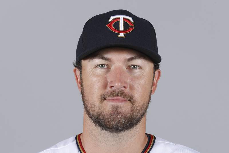 FILE - This is a 2018 file photo showing Minnesota Twins baseball player Phil Hughes. Phil Hughes has retired from baseball, more than two years after throwing his last pitch. The 34-year-old right-hander said on Twitter on Sunday, Jan. 3, 2021, he was announcing what's been fairly apparent  to most of these last couple years. (AP Photo/John Minchillo, File)