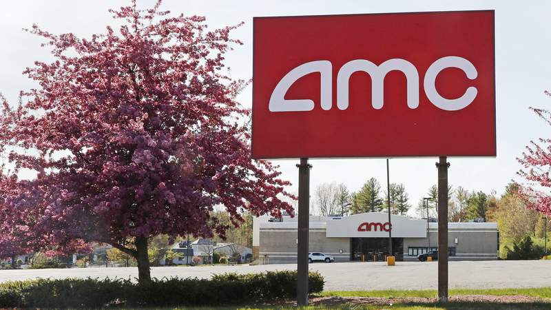 This May 14, 2020, photo shows an AMC theater sign at a nearly empty parking lot for the theater in Londonderry, N.H. After three months of near total blackout of cinemas nationwide, movie theaters are preparing to reopen - even if it means only a few titles on the marquee and showings limited to as little as 25% capacity. (AP Photo/Charles Krupa)