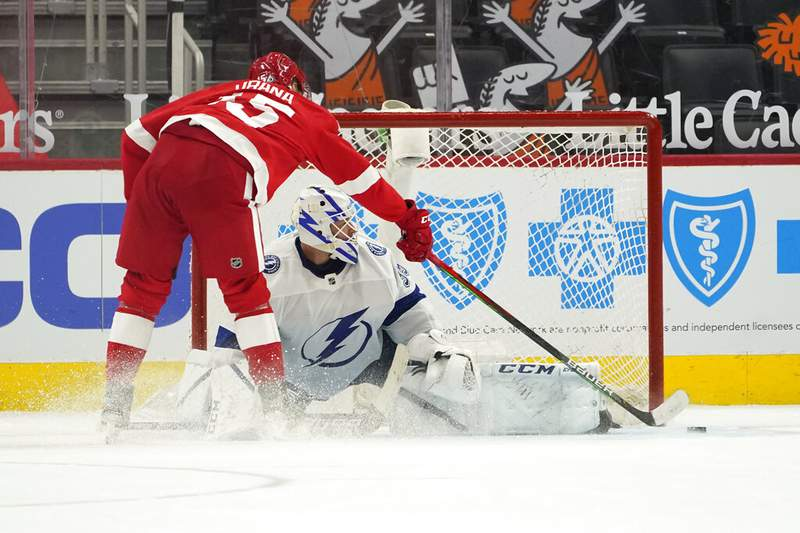 Detroit Red Wings' Jakub Vrana scores on Tampa Bay Lightning goaltender Curtis McElhinney (35) during a shootout in an NHL hockey game Saturday, May 1, 2021, in Detroit. Detroit won 1-0. (AP Photo/Paul Sancya)