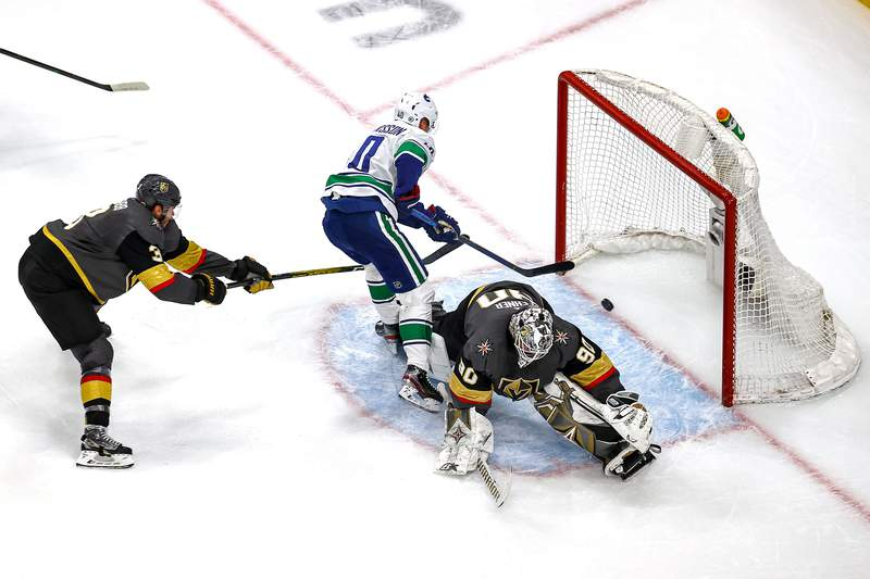 EDMONTON, ALBERTA - AUGUST 25:  Elias Pettersson #40 of the Vancouver Canucks scores a goal past Robin Lehner #90 of the Vegas Golden Knights during the second period in Game Two of the Western Conference Second Round during the 2020 NHL Stanley Cup Playoffs at Rogers Place on August 25, 2020 in Edmonton, Alberta, Canada. (Photo by Bruce Bennett/Getty Images)
