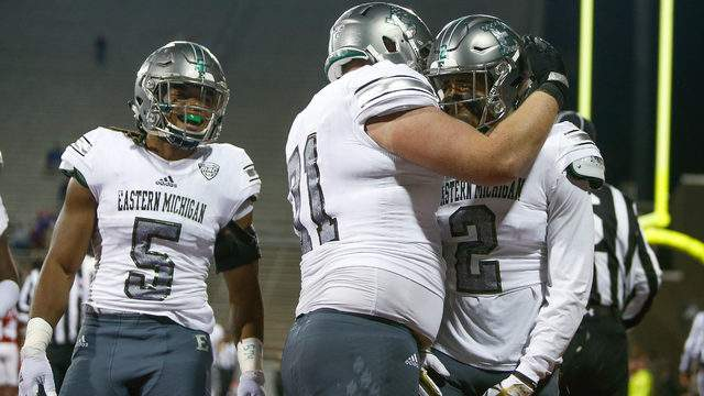 Sergio Bailey II #2 of the Eastern Michigan Eagles celebrates with teammates after a touchdown against the Miami Ohio Redhawks during the second half at Yager Stadium on November 15, 2017 in Oxford, Ohio. (Photo by Michael Reaves/Getty Images)