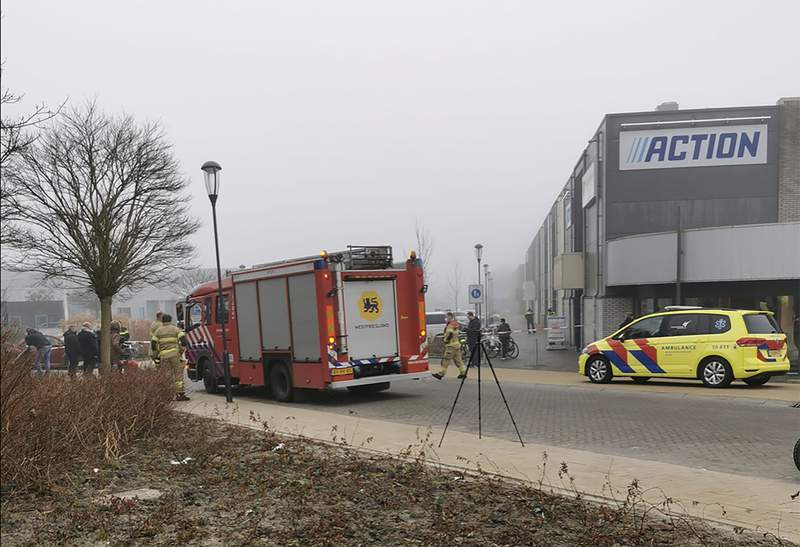 """Emergency services attend the scene close to a coronavirus test station after a homemade firework was detonated in Bovenkarspel, Netherlands, Wednesday March 3, 2021.  The homemade firework, a so-called """"pipe"""" firework, was fired near to the Covid test station Wednesday and broke some windows but no people are reported injured. (Stefanie ter Koele / AP)"""