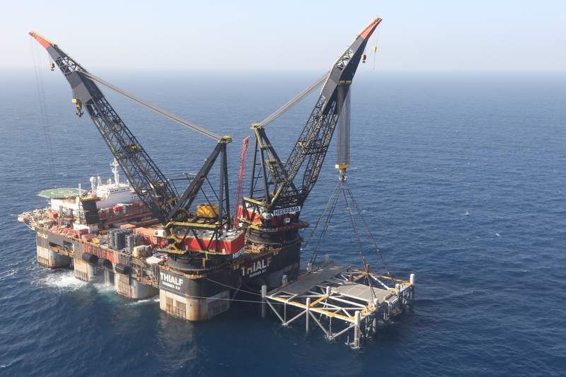 FILE - This Jan. 31, 2019 file photo, shows an oil platform in the Leviathan natural gas field, in the Mediterranean Sea off the Israeli coaast. Israel became a major energy exporter for the first time on Monday, Dec. 16, 2019, after signing a permit to export natural gas to neighboring Egypt. The announcement comes just days before a lucrative Israeli gas field in the Mediterranean Sea is expected to go online. (Marc Israel Sellem/Pool via AP, File)