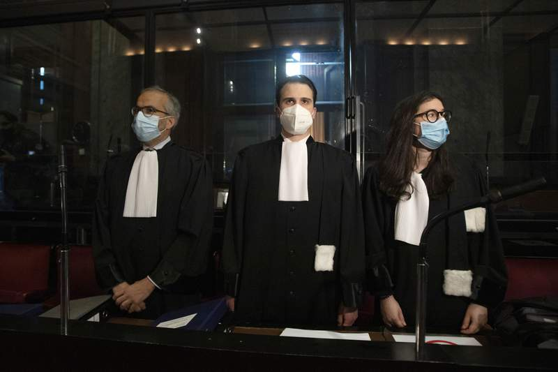 FILE - In this May 26, 2021, file photo, lawyers for AstraZeneca Clemence Van Muylder, right, and Hakim Boularbah, left, wait for the start of a hearing, European Commission vs AstraZeneca, at the main courthouse in Brussels. Coronavirus vaccine-maker AstraZeneca is claiming victory in a court tussle with the European Union over allegations that it was not producing shots fast enough. In a statement Friday, June 18 they said the EUs executive branch, the European Commission, had requested that the drug-maker deliver 120 million vaccine doses in total by the end of June 2021, but that a judge in Brussels ordered delivery of 80.2 million doses by 27 September 2021. (AP Photo/Virginia Mayo, File)