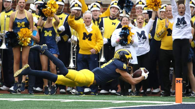 ANN ARBOR, MI - OCTOBER 6: Ronnie Bell #8 of the Michigan Wolverines dives for a first half touchdown while playing the Maryland Terrapins on October 6, 2018 at Michigan Stadium in Ann Arbor, Michigan. (Photo by Gregory Shamus/Getty Images)