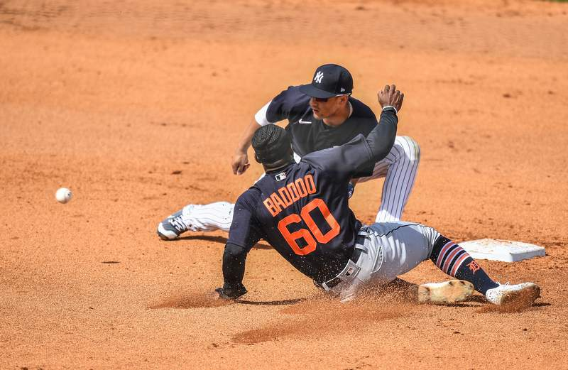 Gleyber Torres #25 of the New York Yankees tags Akil Baddoo #60 of the Detroit Tigers attempting to steal second base in the fifth inning during a spring training game at George M. Steinbrenner Field on March 05, 2021 in Tampa, Florida.