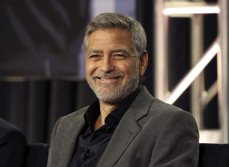 """FILE - In this Feb. 11, 2019 file photo, George Clooney participates in the """"Catch-22"""" panel during the Hulu presentation at the Television Critics Association Winter Press Tour at The Langham Huntington in Pasadena, Calif. In a Sunday, Nov. 29, 2020, interview on CBS Sunday Morning, Clooney said he's been cutting his own hair for more than two decades with a Flowbee device. (Photo by Willy Sanjuan/Invision/AP, File)"""