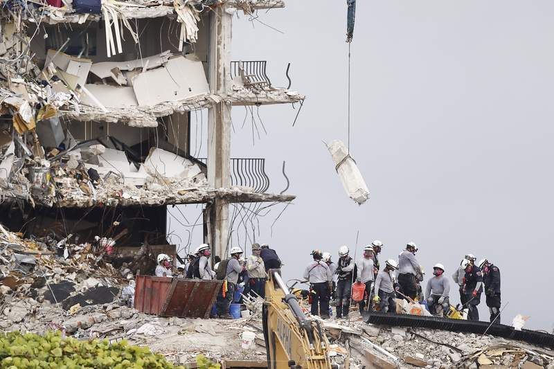 Teams look for possible survivors and remains in the partially collapsed 12-story Champlain Towers South condo building on June 30, 2021 in Surfside, Florida.