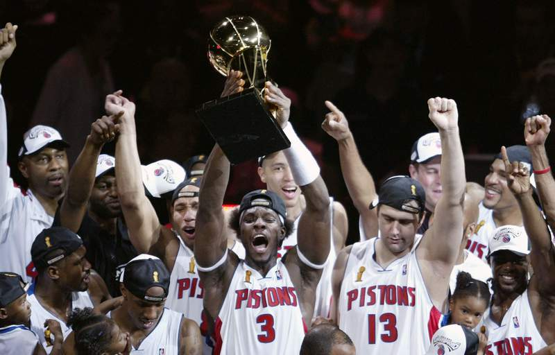 AUBURN HILLS, MI - JUNE 15:  Ben Wallace #3 (C) of the Detroit Pistons holds up the Larry O'Brien NBA Championship trophy as he celebrates with teammatesafter defeating the Los Angeles Lakers 100-87 in game five of the 2004 NBA Finals on June 15, 2004 at The Palace of Auburn Hills in Auburn Hills, Michigan.  NOTE TO USER: User expressly acknowledges and agrees that, by downloading and or using this photograph, User is consenting to the terms and conditions of the Getty Images License Agreement. (Photo by Tom Pidgeon/Getty Images)
