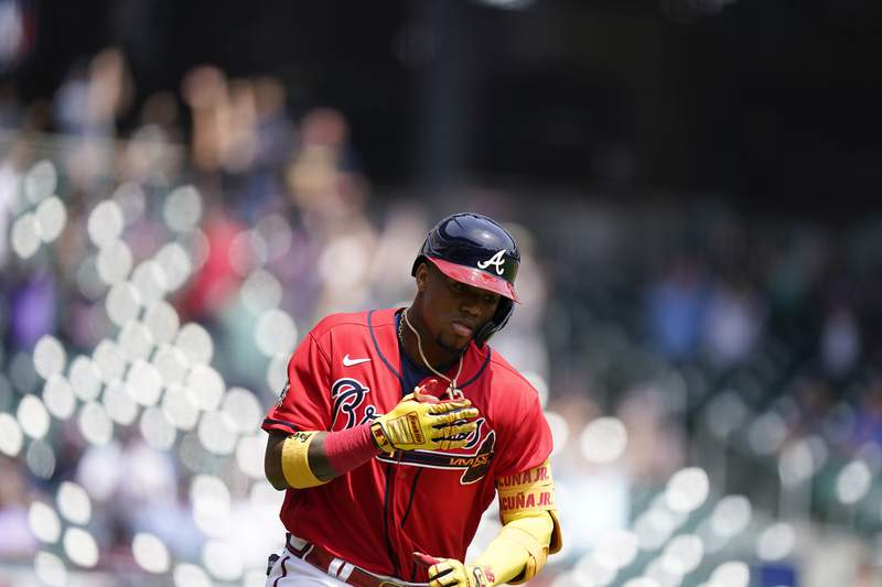 Atlanta Braves' Ronald Acuna Jr. (13) runs after hitting a home run in the fifth inning of a baseball game against the Miami Marlins, Thursday, April 15, 2021, in Atlanta. (AP Photo/Brynn Anderson)