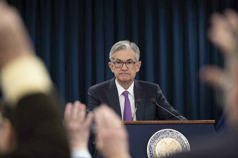 FILE - In this Jan. 30, 2019, file photo, Federal Reserve Chairman Jerome Powell waits for a question from a reporter at a news conference in Washington. Federal Reserve policymakers will meet for two days beginning Tuesday, Sept. 15, 2020, for the first time since they significantly revised the Feds operating framework in ways that will likely keep short-term interest rates near zero for years to come. (AP Photo/Alex Brandon, File)