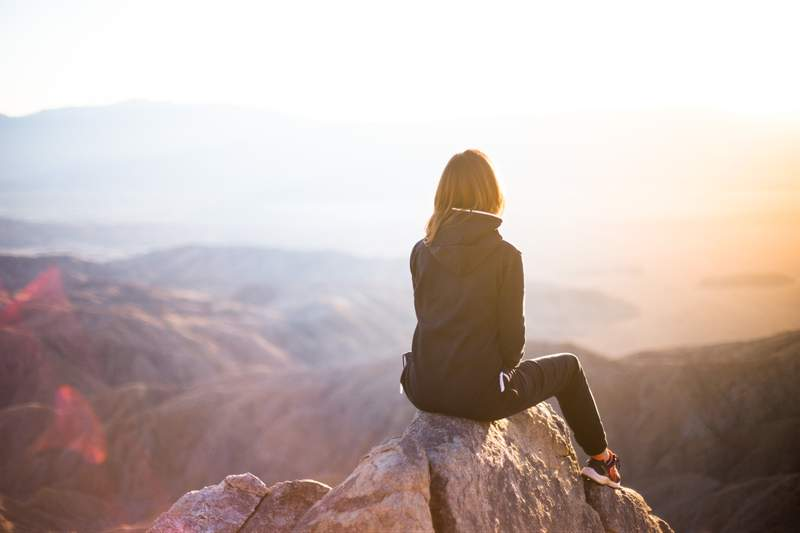 Woman on mountain top