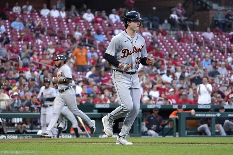 Detroit Tigers' Casey Mize, right, heads to first on a bases-loaded walk as Harold Castro jogs home to score during the second inning of a baseball game Tuesday, Aug. 24, 2021, in St. Louis.