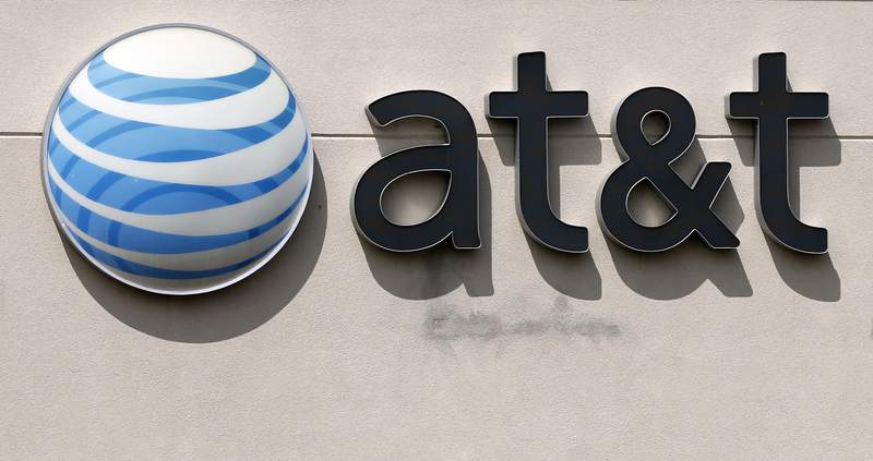 FILE - This May 14, 2014 file photo shows an AT&T logo on a store in Dedham, Mass. AT&T planned to announce details of its upcoming streaming service on Tuesday, Oct. 29, 2019. (AP Photo/Steven Senne, File)