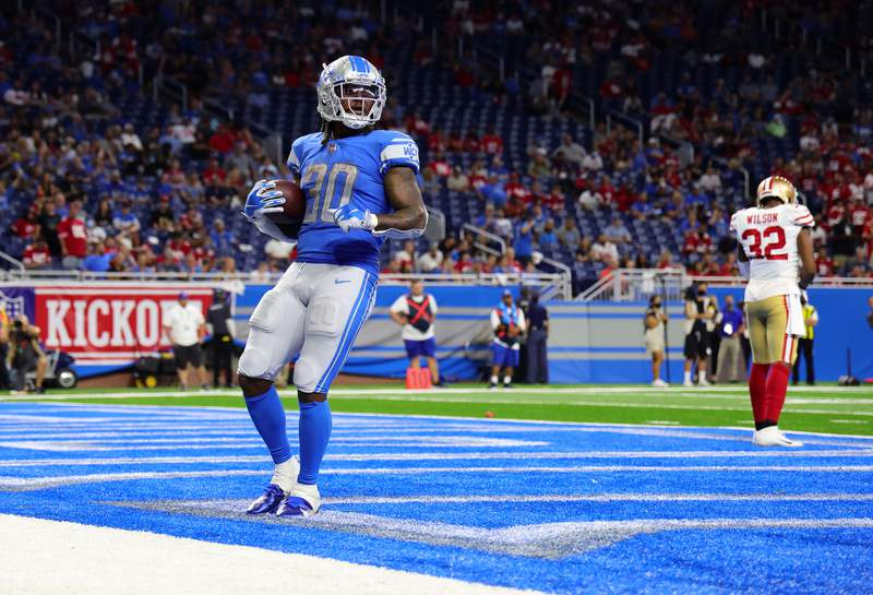 DETROIT, MICHIGAN - SEPTEMBER 12: Jamaal Williams #30 of the Detroit Lions celebrates after scoring a touchdown during the fourth quarter against the San Francisco 49ers at Ford Field on September 12, 2021 in Detroit, Michigan. (Photo by Leon Halip/Getty Images)