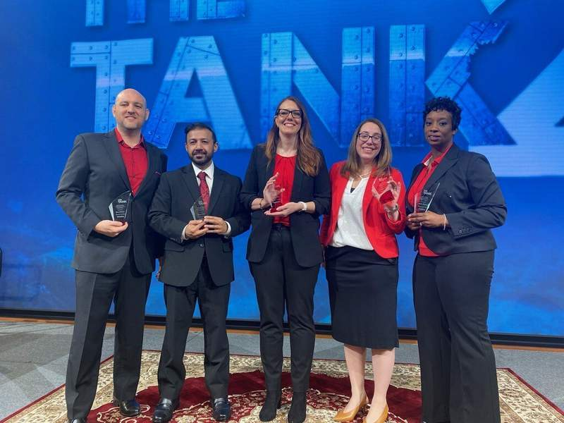 The Toyota for Families team accepts an award for the internal Tank2 competition. (R-L from middle) Jennifer Pelky, Lindsay Babian and Janelle Pharris.